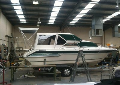 Camper with Windscreen covers and Rear Bimini